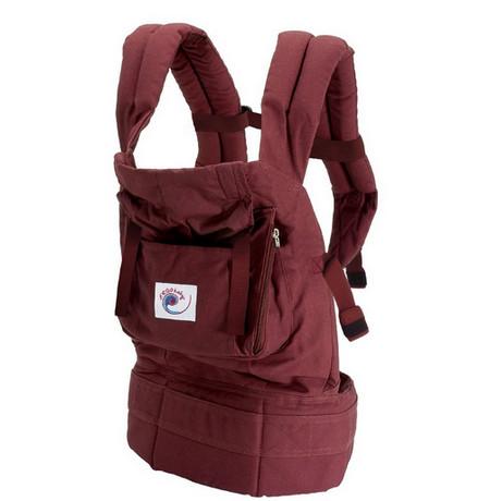 Bestäm villighet barnet att bära i en ergo ryggsäck hjälper enkelt test.  Det är nödvändigt att sätta barnet på en plan yta (utan stöd). c2aeb8c46e91e